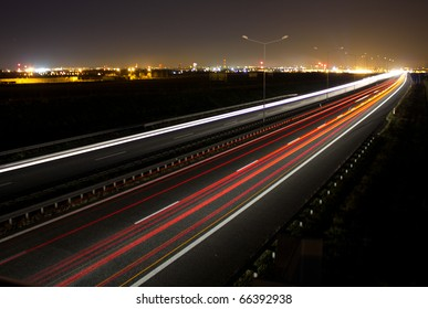Car lights on a highway at night, long exposure photo of traffic