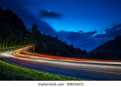 Car Lights Racing Through the Smoky Mountains at Sunrise