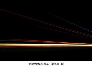 Car ligth trails. Art image . Long exposure photo taken in a tunnel