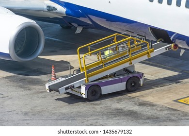 Car for loading luggage compartment of the aircraft is ready, waiting for cargo