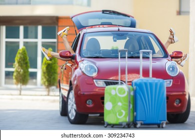 car with luggage bags and travel suitcases before the family vacation. Car trip. summer holidays. car leaving for the travel. Summer holidays concept