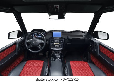 Car luxury inside. Interior of prestige modern car. Front seats with steering wheel, dashboard & gear shift. Black & red cockpit on isolated white background.