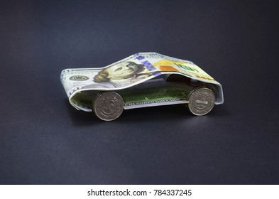 Car made of money in a black background.