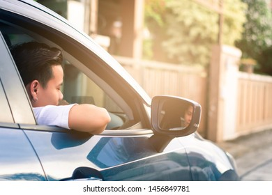 car with man hands up lifestyle driving freedom on street in city blurred background.For automotive automobile or transport transportation image.