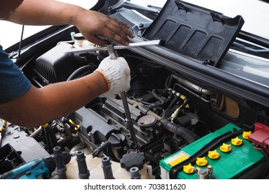 A car mechanic is checking for engine malfunction