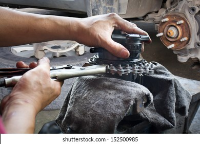 car mechanic fixing parts of automobile at repair service station
