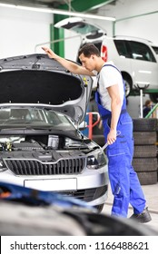car mechanic inspects vehicle in a workshop