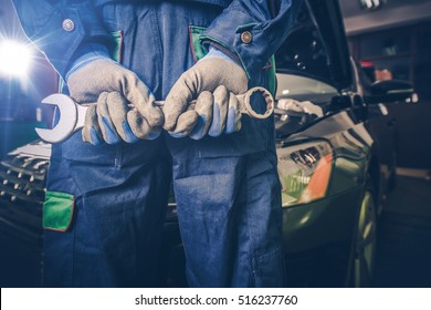 Car Mechanic Ready For Work. Auto Mechanic with Large Wrench in Hands.