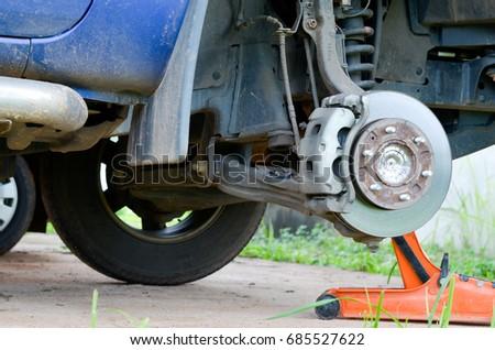 Car Mechanic Repairing Changing Brakes Disc Stock Photo