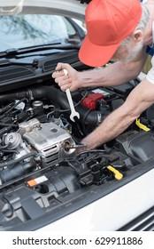 Car mechanic repairing a car engine