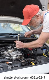 Car mechanic repairing a car engine