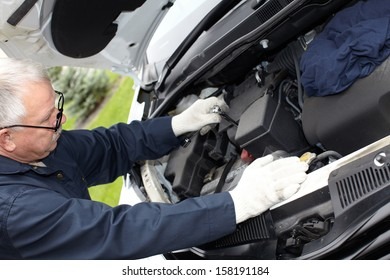 Car mechanic in uniform. Auto repair service.