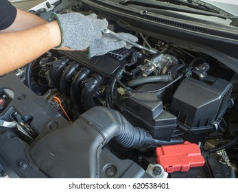 Car mechanic working in auto repair service at auto service center