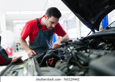 Car mechanic working at automotive service center
