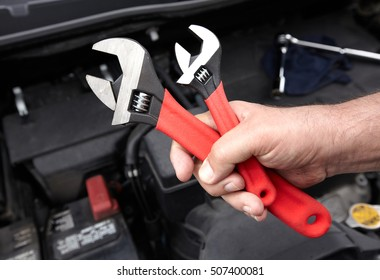 Car mechanic with wrench. - Shutterstock ID 507400081