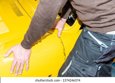 Car mechanics align the bonnet correctly when assembling - Serie Repair Workshop