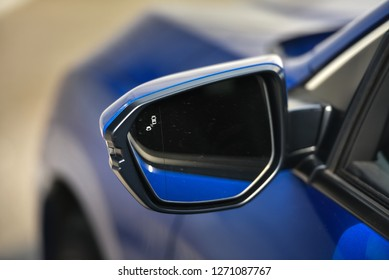 Car mirror with blind spot warning. The car with blind spot monitor which detects other vehicles on the side.