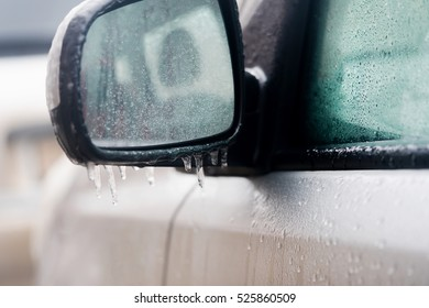 Car mirror with icicles, close-up