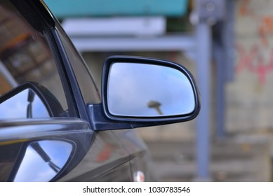 car mirror on wall background.