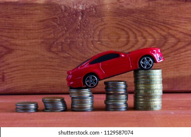 Car model and coins. Concept of auto loan, auto insurance, leasing.