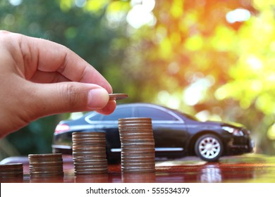 Car model and Financial statement with coins, finance and loan concept, saving money