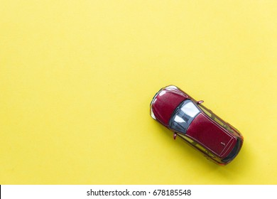 Car model on yellow background with copyspace, image can be used for car rental and car insurance and travelling concept