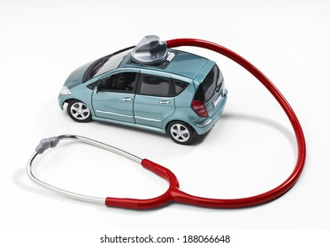 Car is monitored with a stethoscope.