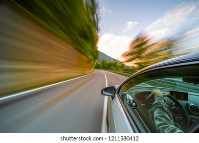 Car in motion blur driving in the Mountains