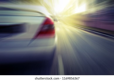 Car with motion blur effect, selective focus.