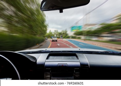 In the car, motion and blur images of beautiful curves as background.