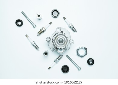 Car motor parts. Auto motor mechanic spare or automotive piece on white background. Set of new metal car part. Flat lay, top view, copy space - Shutterstock ID 1916062129