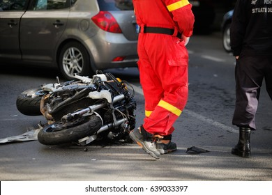 Car and motorcycle road accident