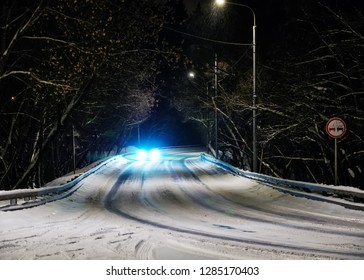 The car moves in a turn on a winter night road