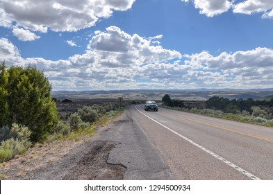 car moving on Utah State Route 12 (Scenic Byway 12) in Garfield County, Utah