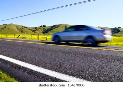 car moving quickly along a road from a low point of view