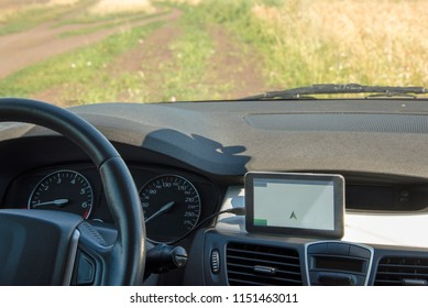 Car with Navigator on a country road in summer. View from inside the car.