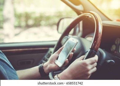 Car navigator. Woman holds the phone while driving
