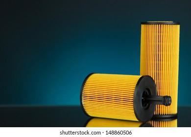 Car oil filters on dark color background
