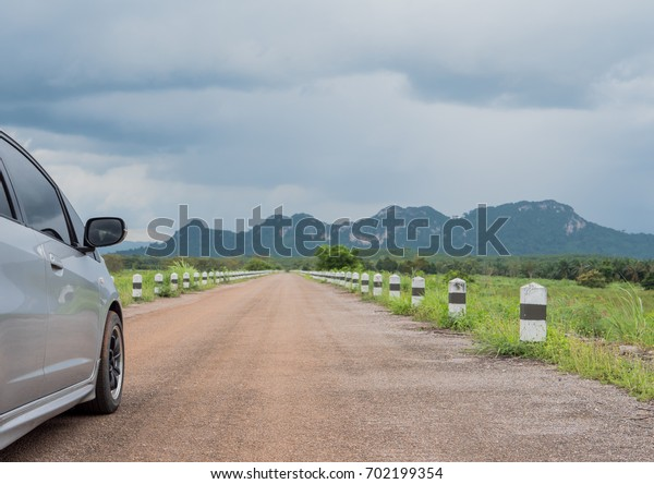 Car on asphalt road in summer evening.