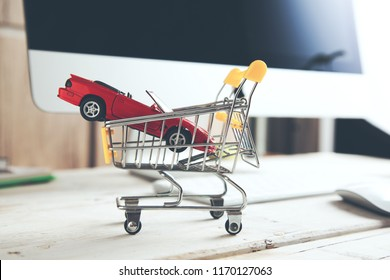 car  on basket with computer on table