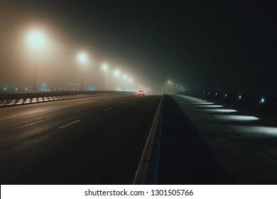 Car on a bridge at Night