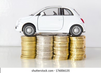 Car on coin stacks