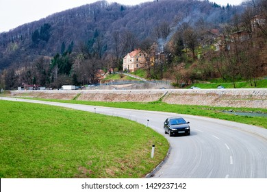 Car on countryside road at Celje old town in Slovenia. Green nature in Slovenija