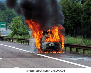 Car on fire in the highway with flames and smoke