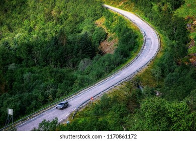 Car on forest road in Norway. Summer landscape