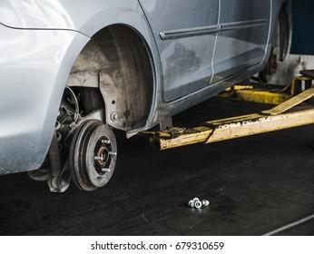 Car on hoist to have brake service. Selective focus.