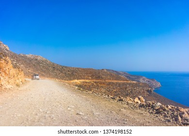 Car on the mountain road on the way to the beach of Balos in Crete