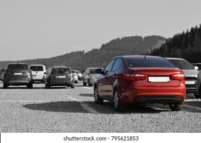 Car on parking in mountains. Black and white image