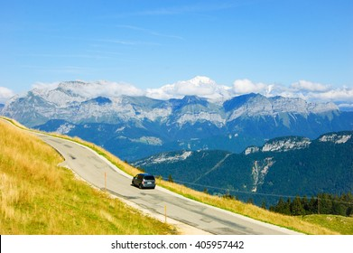 Car on the road at the Alps.