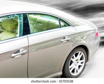 Car on road, digital composite.